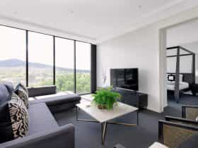 Situated on a high floor with breathtaking views over Glebe Park and Mount Ainslie