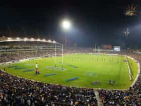 A packed stadium at night