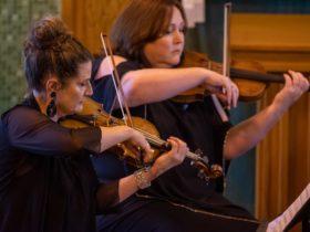 Kirsten Williams and Doreen Cumming playing violins