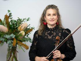 Kirsten Williams holding violin