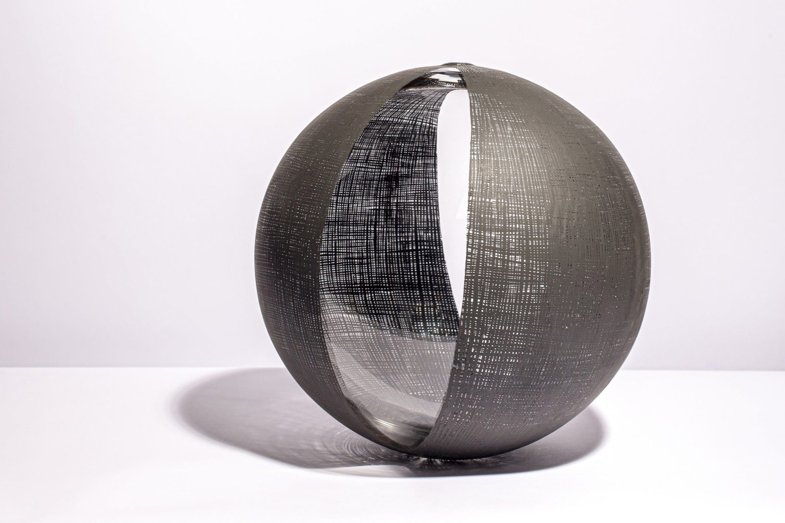 blown glass sphere with black intersecting lines