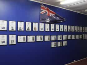 Blue wall with Australian flag displaying a wall of honour
