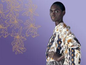Model Magnolia Maymuru standing with a purple background and gold motif deisng on the left.