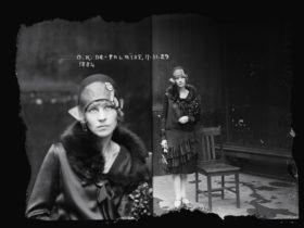1929 mugshot. Women standing next to a chair