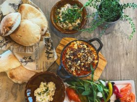 Spread of Lebanese food on wooden table
