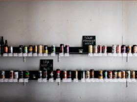 Collection of various beer cans on a shelf