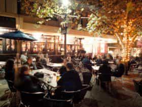Beer garden full of patrons at night