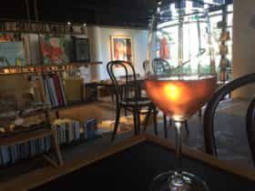 View to the bookstore through a glass of wine