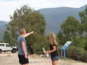 Man pointing towards mountain at Tidbinbilla Nature Reserve