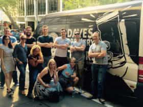 Beer tour participants in front of the Dave's Brewery Tour bus