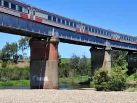 V/Line train crossing a bridge