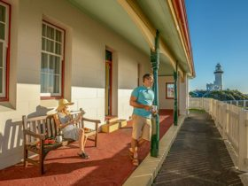 A couple relax on the verandah of the Assistant Lighthouse Keepers Cottage. John Spencer/DPIE