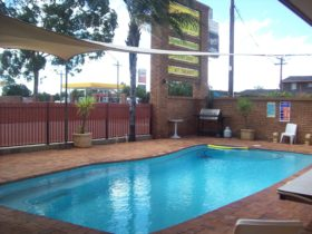 Outside swimming pool and barbecue area