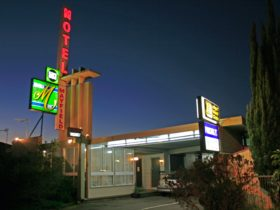 Mayfield Motel front entrance and classic neon signs at night