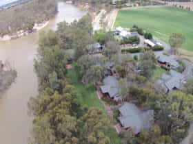 Riverfront, fire pit, boat ramp pool, lawns, gardens, trees