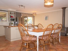 Share a meal in the open plan kitchen / dining area