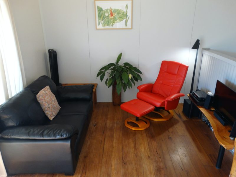 Living space includes comfy leather lounge, chair and footstool, satellite TV , power & USB port