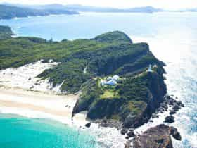 Exquisite aerial of Sugarloaf Point with keepers' cottages, lighthouse ... looking north