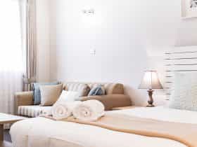A contemporary crisp clean white room with touches of tan and blue