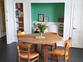 Dining table and four chairs in the upstairs dining area