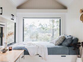Queen bed overlooking surrounding bushland