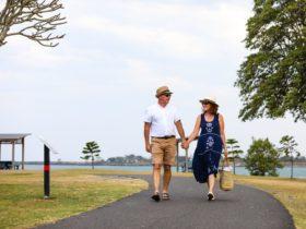 Couple walking along footpath