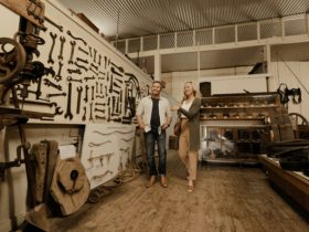 couple exploring old farm utensils at the Federation Museum