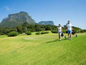 Couple enjoying a round of golf at Lord Howe Island Golf Course