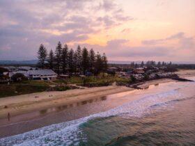 Sun setting over Main Beach, Byron Bay