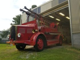 Historical Fire Engine in front of shed
