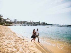 Couple enjoying a walk by Murray Rose Pool, Double Bay