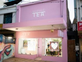 Pink gallery store front with the words Sophie Tea in white writing