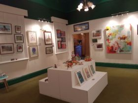 Interior photograph of gallery space showcasing art.