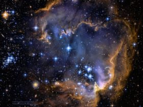 Photograph taken on for NASA shows an explosion of young stars within the gaseous womb like galaxy