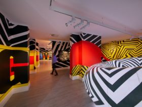 Black and white lines marks various angled walls, with a inflated donut design lit up on the side.