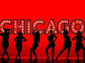 Dancers in front of a sign that says Chicago