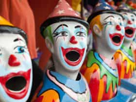 Clowns at side show alley at the Eurobodalla District Show