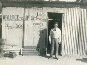 Believed to be Phil McGee in front of Wallace and McGee's shed in Wingewarra St Dubbo c1930s