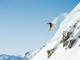 Snowboarding down mountain