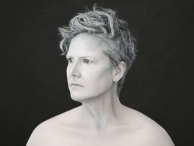 Hannah Gadsby standing in black and white portrait style