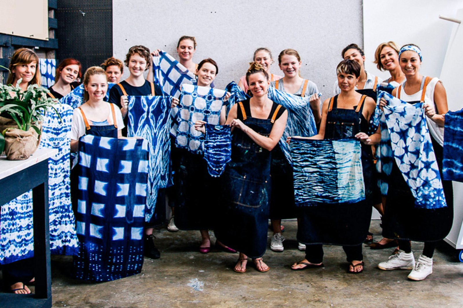 shibori classes with indigo, class members holding their work