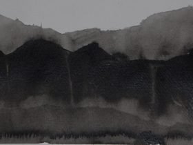 Black and white landscape of distant mountains