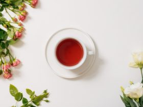 Top view of tea cup surrounded by flowers