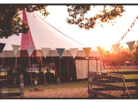 The bigtop venue through bunting at Sunset