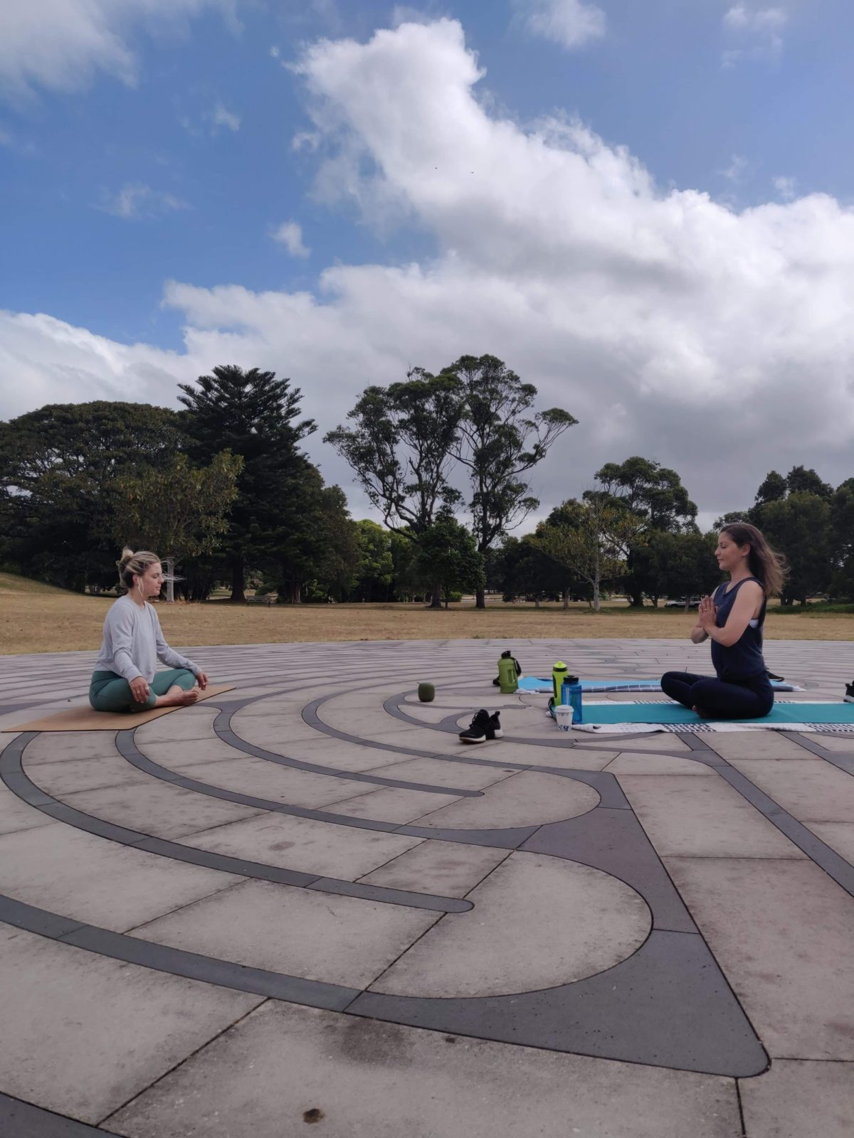 alanna and student in outdoor seated meditation