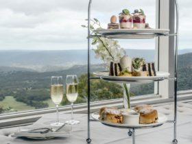 Image of high tea - champagne, scones and mini desserts