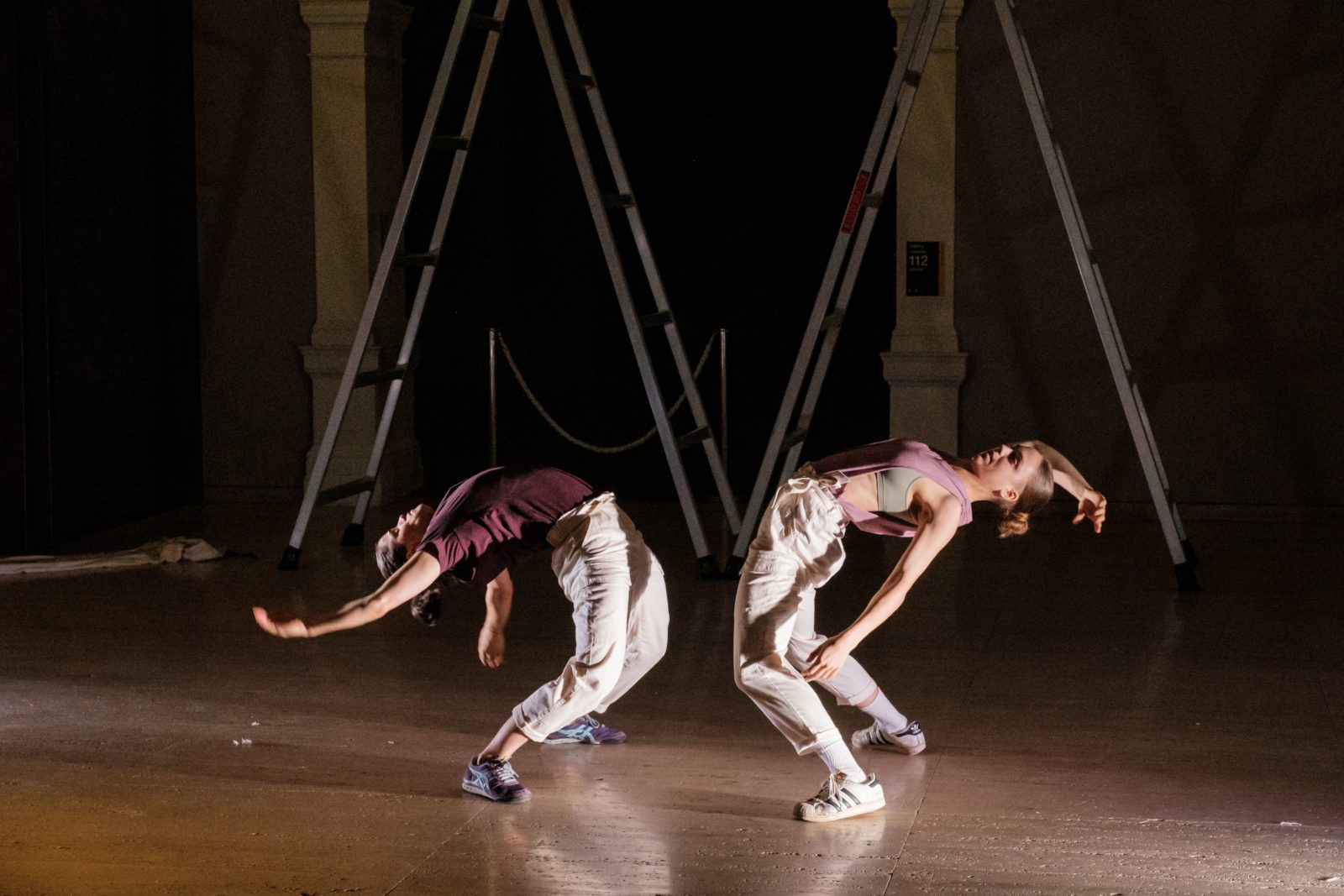 Side view of two dancers facing each other