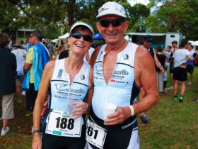 Two triathletes with post race smiles