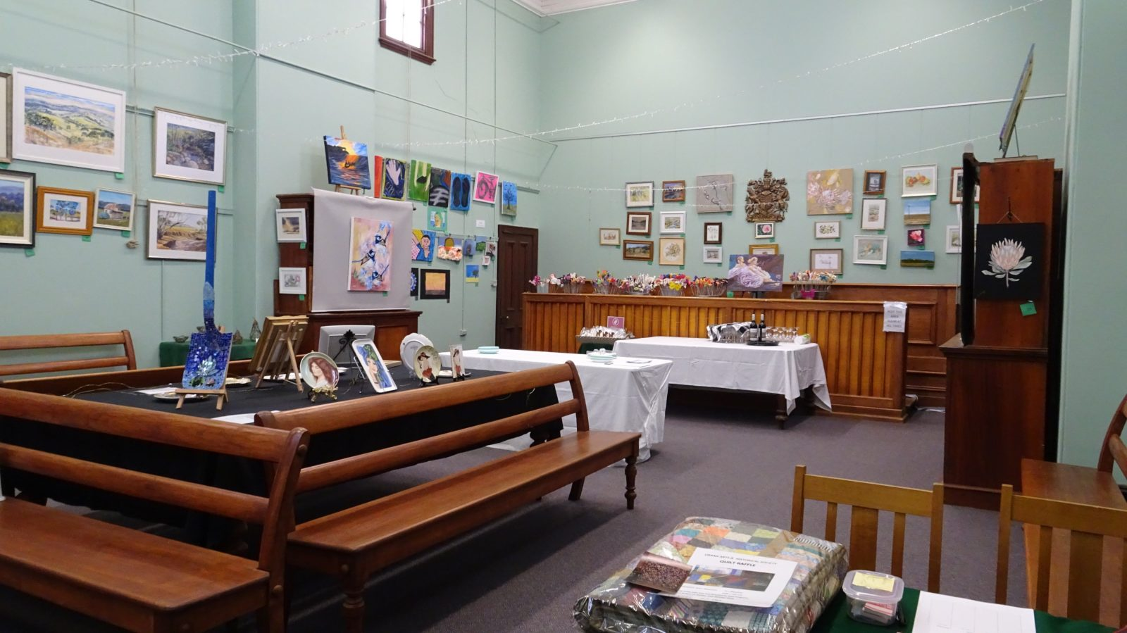 Art work is displayed around the Old Courthouse Museum. All artwork is for Sale.