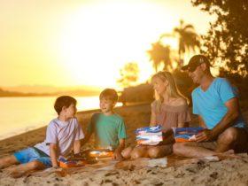 Family eating on river